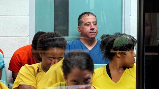 Mahmoud Yousef Hindi, dressed in blue in the upper right, awaits his arraignment at the local jail on Saturday, Sept. 8, 2012, in Louisville, Ky. Hindi is accused of killing a neighbor and wounding another at a homeowners association meeting Thursday evening. (AP Photo/Bruce Schreiner)