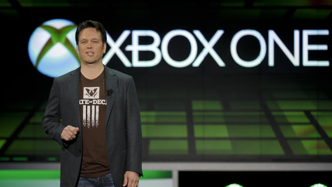 Phil Spencer of Microsoft Game Studios speaks at the Microsoft Xbox E3 media briefing in Los Angeles, Monday, June 10, 2013. Microsoft focused on how cloud computing will make games for its next-generation Xbox One console more immersive during its Monday presentation at the Electronic Entertainment Expo. Microsoft announced last week that the console must be connected to the Internet every 24 hours to operate, and the system would ideally always be online. (AP Photo/Jae C. Hong)