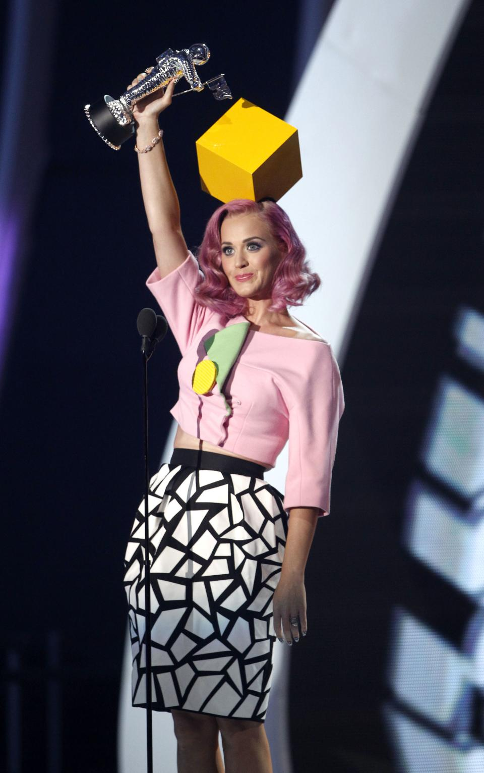 "Katy Perry accepts the award for video of the year for ""Firework"" at the MTV Video Music Awards on Sunday Aug. 28, 2011, in Los Angeles. (AP Photo/Matt Sayles)"