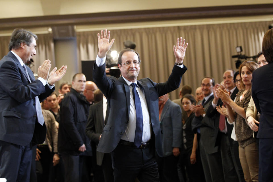 French President-elect Francois Hollande, waves after delivering a speech during the Socialist Party's national council, in Paris, Monday, May 14, 2012. (AP Photo/Christophe Ena)