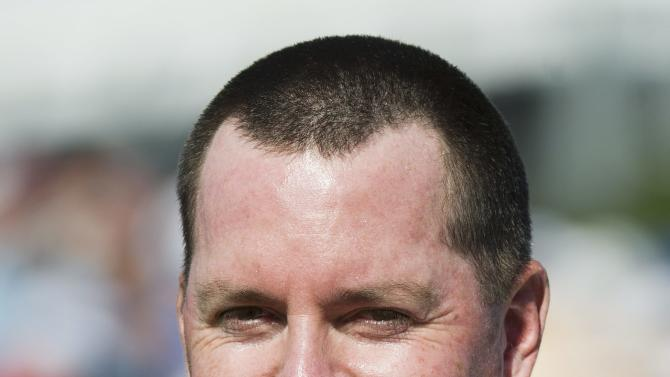 Robert Garrigus reacts by biting his hat after missing a put to force a play-off on 18 during final round play at the 2012 Canadian Open at the Hamilton Golf and County Club in Ancaster, Ontario, on Sunday, July 29, 2012. (AP Photo/The Canadian Press, Nathan Denette)