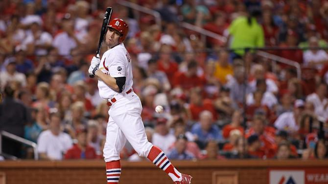 St. Louis Cardinals' Peter Bourjos reacts as he is hit by a pitch during the sixth inning of a baseball game against the Cincinnati Reds Monday, July 27, 2015, in St. Louis. (AP Photo/Scott Kane)