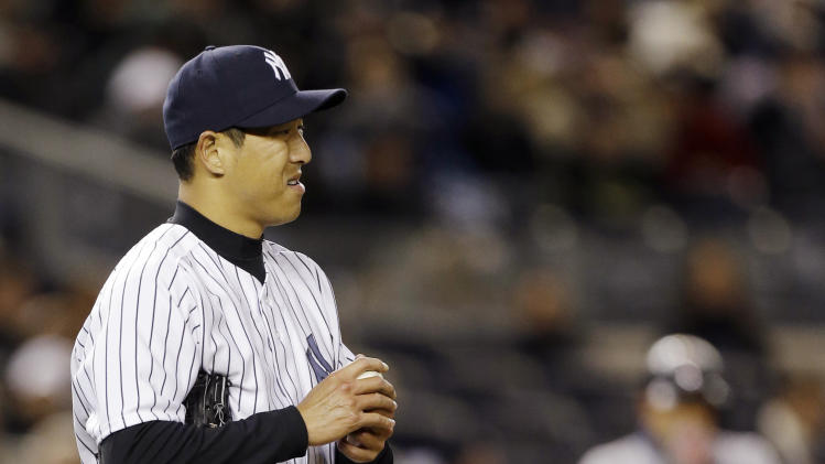 New York Yankees starting pitcher Hiroki Kuroda grimaces on the mound after loading the bases in the second inning of a baseball game against the Boston Red Sox at Yankee Stadium in New York, Wednesday, April 3, 2013. (AP Photo/Kathy Willens)