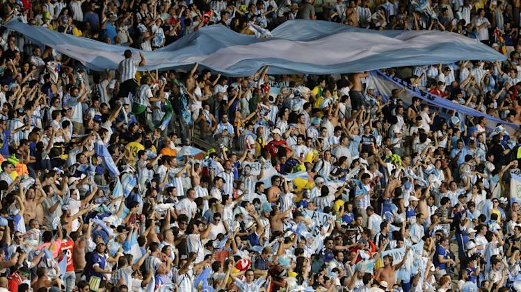 Argentina's fans celebrate after the group F World Cup soccer match between Argentina and Iran at the Mineirao Stadium in Belo Horizonte, Brazil, Saturday, June 21, 2014. Lionel Messi scored a superb goal in stoppage time to give Argentina a 1-0 victory over Iran