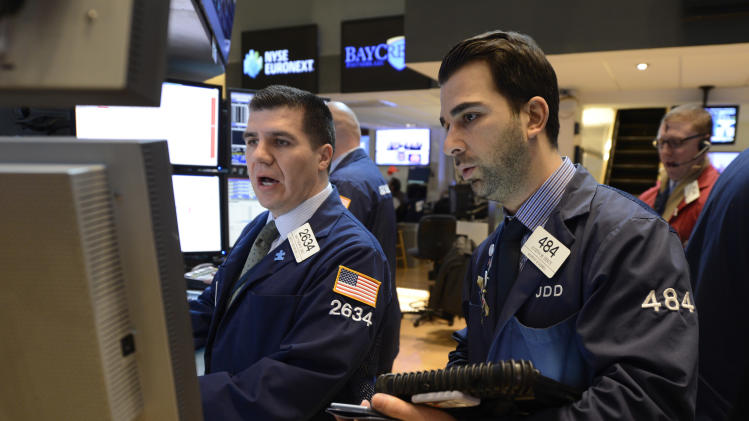 Matthew Dez, left, of Getco Securities and Joseph Dente of Murphy and Durieu work on the floor of the New York Stock Exchange, Wednesday, Feb. 13, 2013 in New York. (AP Photo/Henny Ray Abrams)