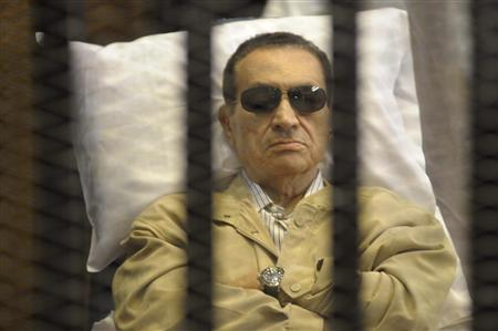 Former Egyptian President Hosni Mubarak sits inside a cage in a courtroom in Cairo June 2, 2012. REUTERS/Stringer