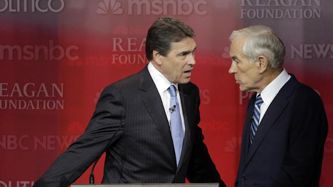 Republican presidential candidates Rick Perry, left, and Rep. Ron Paul, R-Texas, talk during a break at a Republican presidential candidates debate at the Reagan Library Wednesday, Sept. 7, 2011, in Simi Valley, Calif.  (AP Photo/Jae C. Hong)
