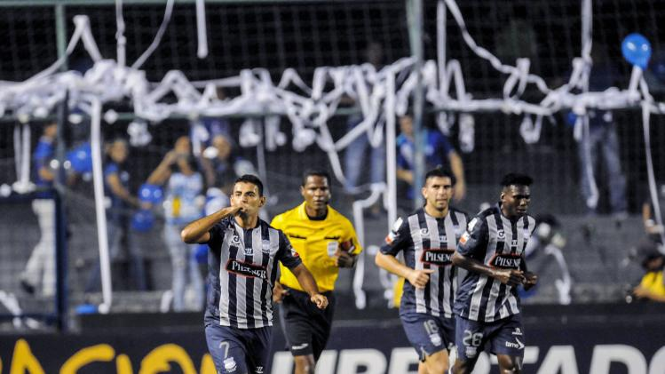 Ecuador's CS Emelec player Escalada celebrates with teamates Stracqualursi and Lastra after scoring against Mexico's Leon FC during their second leg match of the Copa Libertadores in Guayaquil.