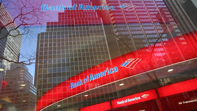 """FILE - In this Jan. 25, 2009 file photo, a Bank of America branch office is shown in New York. The U.S. government urged that Bank of America Corp pay $863.6 million in damages after a federal jury found it liable for fraud over defective mortgages sold by its Countrywide unit. In a filing late Friday, Nov. 8, 2013, in the U.S. District Court in Manhattan, the government also asked for penalties against Rebecca Mairone, a former midlevel executive at the bank's Countrywide unit who the jury also found liable, """"commensurate with her ability to pay."""" Bank of America and Mairone were each found liable for defrauding government-controlled mortgage companies Fannie Mae and Freddie Mac through the sale of shoddy loans purchased from Countrywide in 2007 and 2008. (AP Photo/Mark Lennihan, file)"""