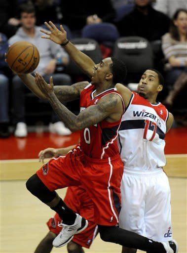 'I'm back': Wall has 14; Wizards top Hawks 93-83