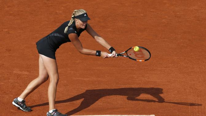 Kristina Mladenovic of France plays a shot to Eugenie Bouchard of Canada during their women's singles match at the French Open tennis tournament at the Roland Garros stadium in Paris