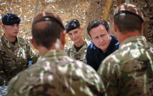 British Prime Minister David Cameron meets British soldiers based at Lashkar Gah in Helmand Province. Cameron visited frontline troops at the start of his visit to Afghanistan and defended the decision to withdraw from the war-torn country, according to British officials