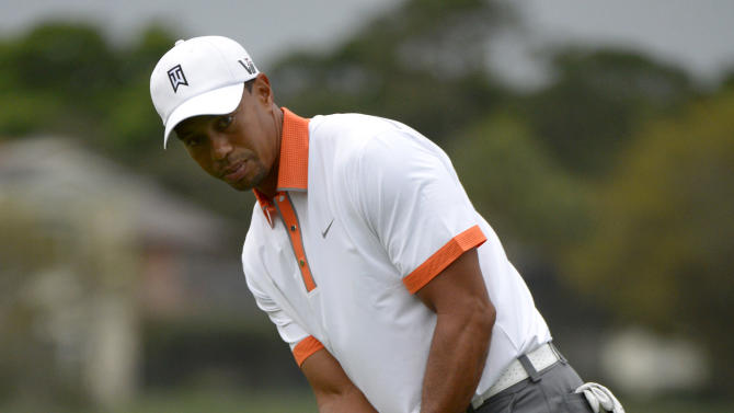 Tiger Woods watches his putt on the third green during the pro-am of the Arnold Palmer Invitational golf tournament in Orlando, Fla., Wednesday, March 20, 2013.(AP Photo/Phelan M. Ebenhack)