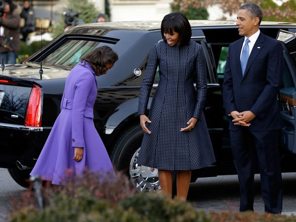 Michelle Obama joins her husband, President Barack Obama and her daughters Sasha and Malia, for the Inauguration Day ceremonies on Jan. 21, 2013. Fittingly, the First Lady wears a blue Thom Browne coa