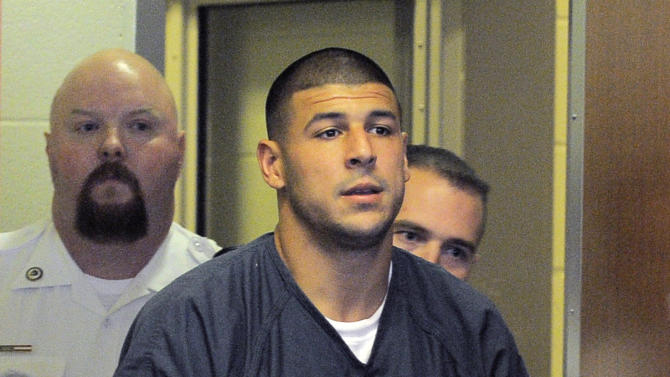 Former New England Patriots football player Aaron Hernandez enters a courtroom for a bail hearing in Fall River Superior Court Thursday, June 27, 2013 in Fall River, Mass. Hernandez, charged with murdering Odin Lloyd, a 27-year-old semi-pro football player, was denied bail. (AP Photo/Boston Herald, Ted Fitzgerald, Pool)