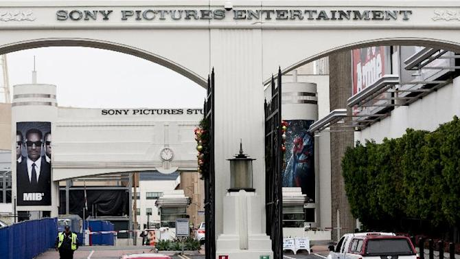 "Cars enter and depart from Sony Pictures Entertainment studio lot in Culver City, Calif., Thursday, Dec. 18, 2014. Companies across the globe are on high alert to tighten up network security to avoid being the next company brought to its knees by hackers like those that executed the dramatic cyberattack against Sony Pictures Entertainment. The hack, which a U.S. official has said investigators believe is linked to North Korea, culminated in the cancellation of a Sony film, ""The Interview,"" and ultimately could cost the movie studio hundreds of millions of dollars.  (AP Photo/Damian Dovarganes)"