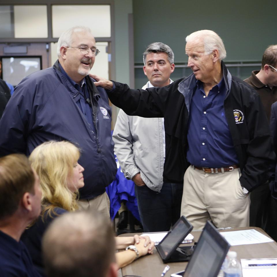 Vice President Joe Biden, right, talks with FEMA Administrator Craig Fugate after a briefing on the floods in Colorado at the FEMA Disaster Recovery Center in Greeley, Colo., Monday, Sept. 23, 2013. Biden took a helicopter tour of the flood damage in Colorado before meeting with officials at the center. AP Photo/Ed Andrieski)