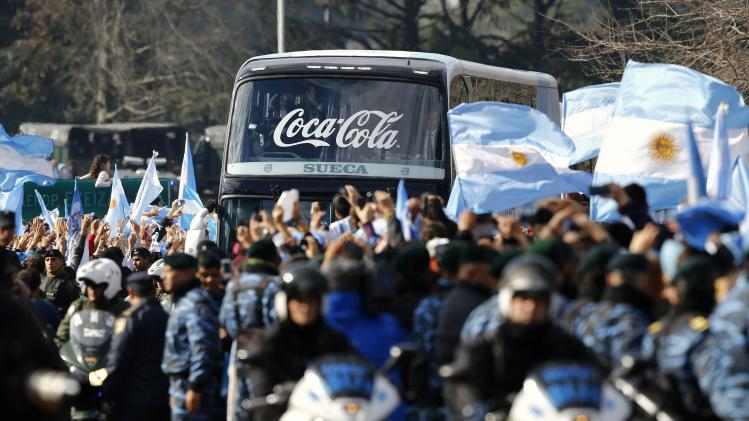 Argentina's national soccer team arrives at the Argentine Football Association as they are welcomed by fans in Buenos Aires