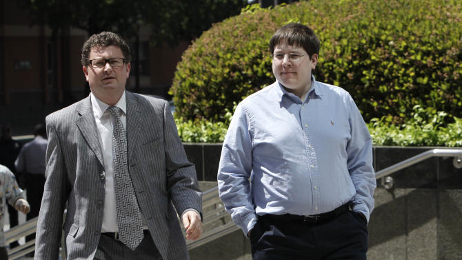 Matthew Keys, right, a social media editor who faces federal charges that he allegedly conspired with a hacker to deface the website of the Los Angeles Times, walks to the federal courthouse for his arraignment with his attorney Jason Leiderman, in Sacramento, Calif., Tuesday, April 23, 2013. Keys pleaded not guilty to charged with giving the hacking group, Anonymous, the log-in credentials to the computer system of the Tribune Co., which owns the Los Angeles Times, Chicago Tribune, Baltimore Sun and other media properties. (AP Photo/Rich Pedroncelli)