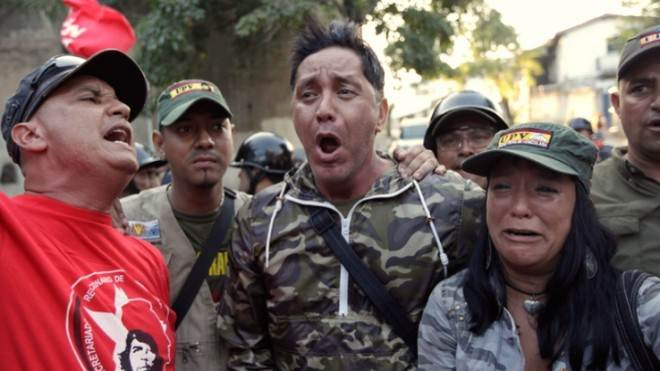 Venezuelan supporters of Hugo Chavez react in Caracas after hearing of the president's death on March 5.