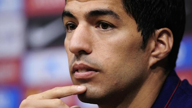 FC Barcelona's Luis Suarez, from Uruguay, attends a press conference of his presentation at the Camp Nou in Barcelona, Spain, Tuesday, Aug. 19, 2014. Barcelona unveiled Suarez on Tuesday, an event delayed for over five weeks since his transfer from Liverpool due to his latest suspension for biting an opponent at the World Cup. (AP Photo/Manu Fernandez)