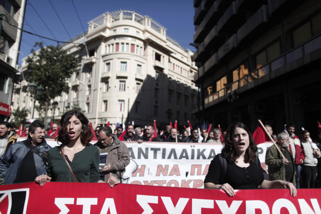Members of pro-communist union PAME shout slogans during a protest in Athens, Wednesday, Feb. 20, 2013. Thousands of anti-austerity demonstrators took to the streets of Athens on Wednesday as unions s
