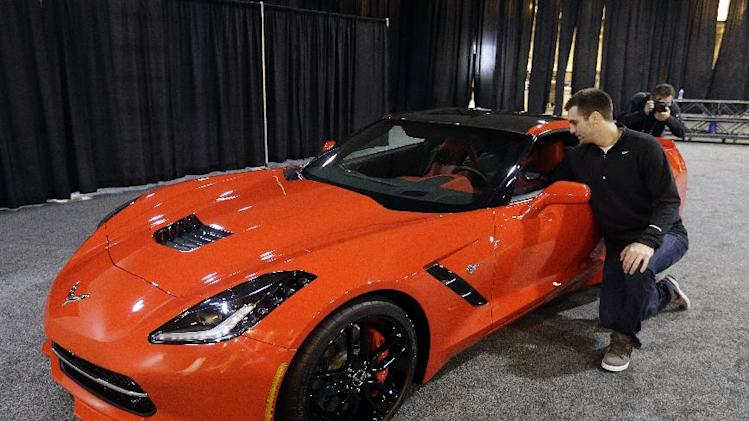 Baltimore Ravens quarterback Joe Flacco looks at the inside of 2014  Corvette Stingray following a news conference after NFL Super Bowl XLVII football game Monday, Feb. 4, 2013, in New Orleans. The Ravens defeated the San Francisco 49ers 34-31.(AP Photo/Darron Cummings)