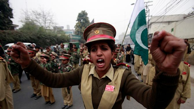 A female student chants slogans with others to condemn the attack by Taliban gunmen on the Army Public School in Peshawar, during a rally in Lahore