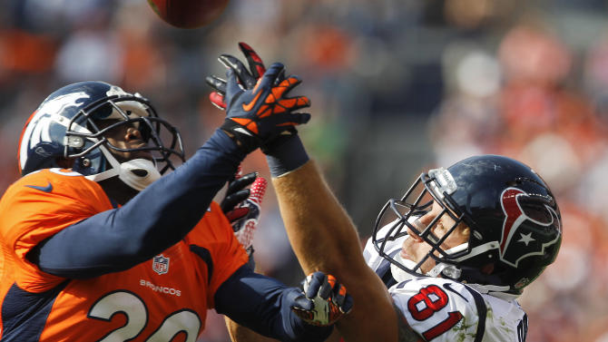 Denver Broncos strong safety Mike Adams (20) breaks up a pass intended for Houston Texans tight end Owen Daniels (81) in the third quarter of an NFL football game Sunday, Sept. 23, 2012, in Denver. (AP Photo/David Zalubowski)