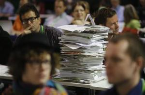 File photo of congress documents piled up during a party congress of Germany's environmental party The Greens in Berlin