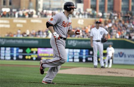 Baltimore Orioles Chris Davis rounds the bases after hitting a solo home run against Detroit Tigers Max Scherzer during their MLB game in Detroit