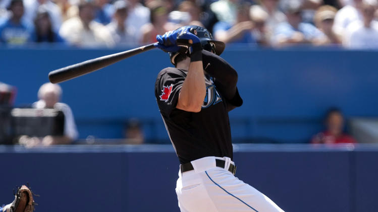 Toronto Blue Jays' Colby Rasmus hits a double to deep center off Texas Ranger pitcher C.J Wilson during the fourth inning of a baseball game in Toronto, Sunday, July 31, 2011. (AP Photo/The Canadian Press, Chris Young)