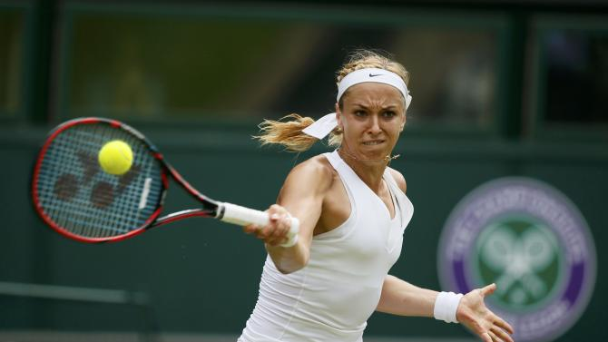 Sabine Lisicki of Germany hits a shot during her match against Christina McHale of the U.S.A. at the Wimbledon Tennis Championships in London
