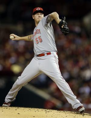 Cincinnati Reds starting pitcher Mat Latos throws during the first inning of a baseball game against the St. Louis Cardinals, Tuesday, Oct. 2, 2012, in St. Louis. (AP Photo/Jeff Roberson)