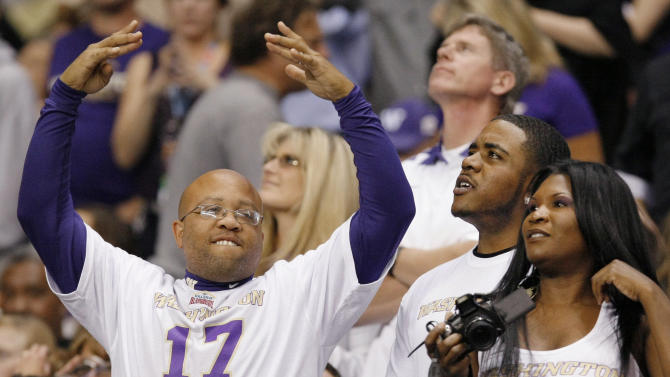 Washington fans celebrate during the first half of the Alamo Bowl college football game between Washington and Baylor, Thursday, Dec. 29, 2011, at the Alamodome in San Antonio. (AP Photo/Darren Abate)