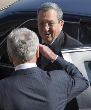 Defense Secretary Chuck Hagel salutes Israeli Defense Minister Ehud Barak as he arrives at the Pentagon for an honor cordon, Tuesday, March 5, 2013. (AP Photo/Carolyn Kaster)