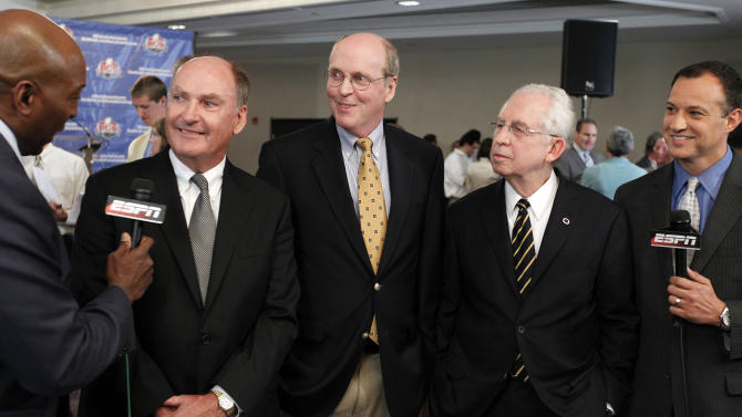 Big Ten Commissioner Jim Delany, second from left, BCS executive director Bill Hancock, center, and SEC Commissioner Mike Slive, second from right, smile during an interview after a BCS presidential oversight committee meeting and media availability, Tuesday, June 26, 2012, in Washington. A committee of university presidents on Tuesday approved the BCS commissioners' plan for a four-team playoff to start in the 2014 season. (AP Photo/Alex Brandon)