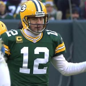 Green Bay Packers quarterback Aaron Rodgers tries to quiet Lambeau crowd