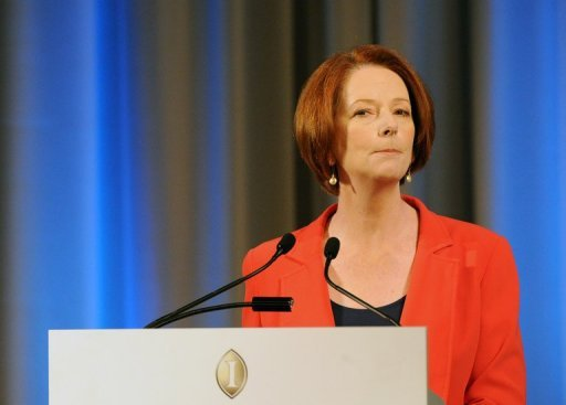 <p>Australian Prime Minister Julia Gillard (pictured on August 7) defended her decision to send asylum-seekers, arriving by boat, to Pacific islands, saying it was a 'tough' policy but could save lives.</p>