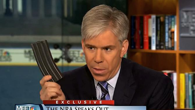 "This image made from video provided by NBC's ""Meet the Press"" shows host David Gregory holding what he described as a high-capacity ammunition magazine during the taping of the Sunday, Dec. 23, 2012 program. He was interviewing National Rifle Association executive vice president Wayne LaPierre and used the magazine as a prop while discussing gun control. Gregory won't face charges for possession of a high-capacity magazine D.C. prosecutors announced Friday, Jan. 11, 2013 saying criminal charges wouldn't serve the public's best interests. (AP Photo/Meet the Press)"