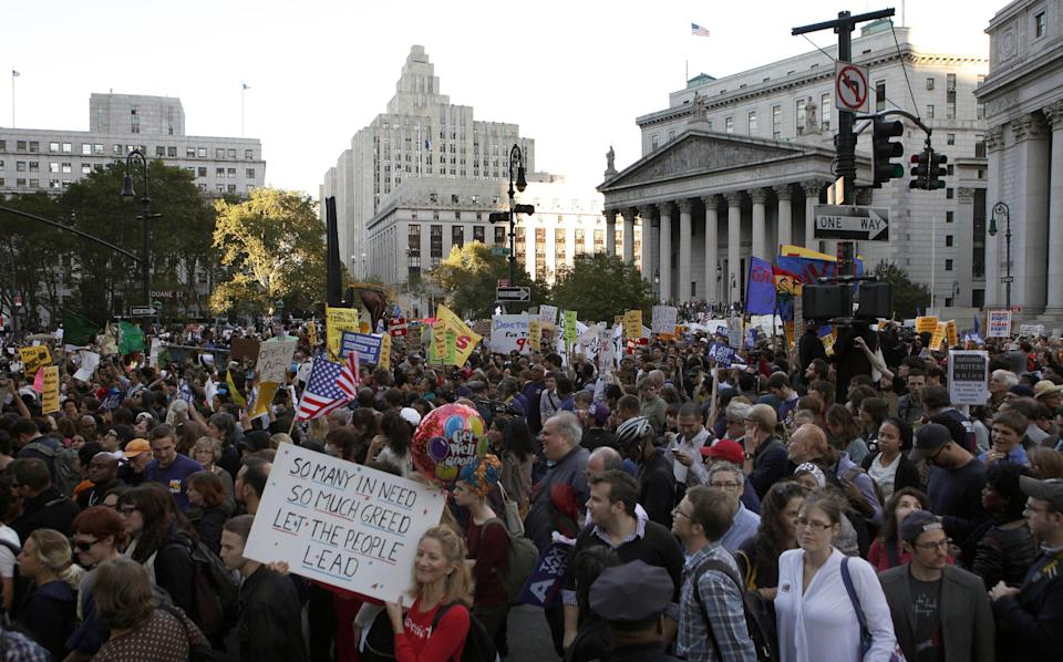 Occupy Wall Street protesters march with a labor union rally out of Foley Square on their way towards Zuccotti Park in New York's Financial District, Wednesday, Oct. 5, 2011. (AP Photo/Jason DeCrow)