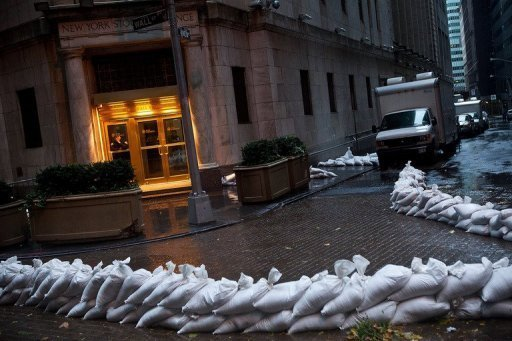 <p>The New York Stock Exchange barricaded with sand bags on October 29, 2012 before the arrival of Hurricane Sandy. The New York Stock Exchange and the Nasdaq exchange were set to reopen on Wednesday after Hurricane Sandy forced a two-day shutdown, the markets' first closure since the September 11 attacks of 2001.</p>
