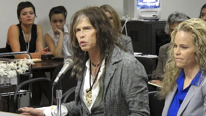 Aerosmith lead singer Steven Tyler testifies on celebrity privacy during a hearing at the Hawaii Capitol in Honolulu on Friday, Feb. 8, 2013. Rock legends StevenTyler and Mick Fleetwood convinced a Hawaii Senate committee on Friday to approve a bill to protect celebrities or anyone else from intrusive paparazzi. The state Senate Judiciary Committee approved the so-called StevenTyler Act after the stars testified. The bill would give people power to sue others who take photos or video of their private lives in an offensive way. (AP Photo/Oskar Garcia)