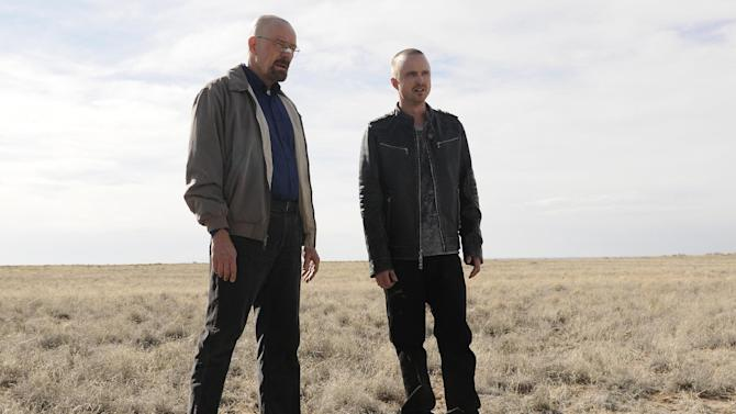 """This image released by AMC shows Bryan Cranston as Walter White, left, and Aaron Paul as Jesse Pinkman in a scene from the season 5 premiere of """"Breaking Bad,"""" airing Sunday, July 15, at 10 p.m. EST on AMC. (AP Photo/AMC, Ursula Coyote)"""