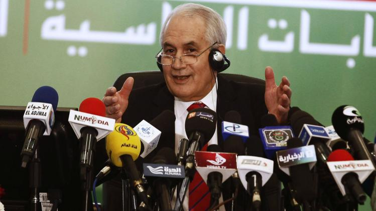 Algerian Interior Minister Belaiz announces President Bouteflika's re-election victory to the media in Algiers