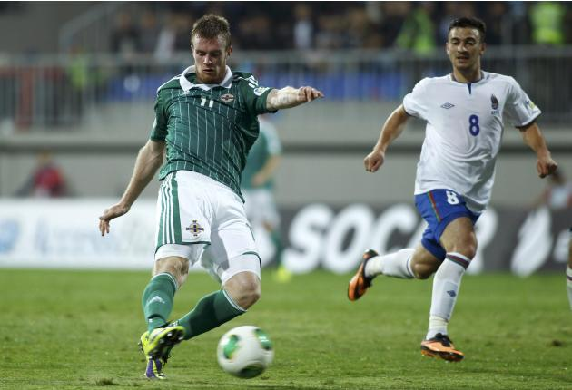 Brunt of Northern Ireland is challenged by Qarayev of Azerbaijan during their 2014 World Cup qualifying soccer match in Baku