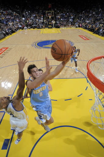 Nuggets rally to beat Warriors in double OT