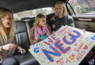 "In this April 13, 2011 photo, Jessica Rees, center, and her mother, Stacey Rees, right, are handed posters by Jessica's first-grade teacher Kim Moore, left, as they board a limousine to attend an ""American Idol"" taping in Rancho Santa Margarita, Calif. Jessica Joy Rees, 12, who started a blog and a Facebook page to raise awareness about child cancer has died of brain tumors. Her family says Jessica died Thursday, Jan. 5, 2012 after a 10-month battle with cancer. Jessica Rees began her blog after she became sick in March. Her Internet posts described her feelings and urged her readers to pray for other children with cancer. (AP Photo/Orange County Register, Ana Venegas) MAGS OUT; LOS ANGELES TIMES OUT"