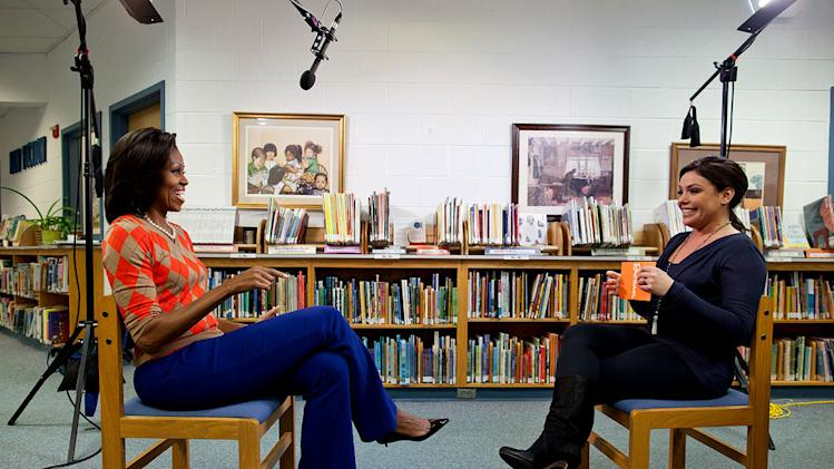 "First Lady Michelle Obama participates in an interview with celebrity chef Rachael Ray at Parklawn Elementary School in Alexandria, Va., Jan. 25, 2012 as seen on ""The Rachael Ray Show."""