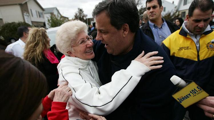 "Angela Cimillo, of Moonachie, N.J., whose home was damaged during Superstorm Sandy, left, hugs New Jersey Gov. Christie Thursday, Nov. 1, 2012, as the governor toured the flood-ravaged area. The flooding of Moonachie, Little Ferry and Carlstadt, three communities sandwiched between Teterboro Airport, MetLife Stadium and the Hackensack River, was caused by six dirt berms that broke from the pressure of a tidal surge, Christie said. More than 1.7 million customers in New Jersey remain without power _ down from over 2.7 million at the height of the outages. ""Take care of us,"" Cimillo told Christie. (AP Photo/The Record of Bergen County, Kevin R. Wexler, Pool)"